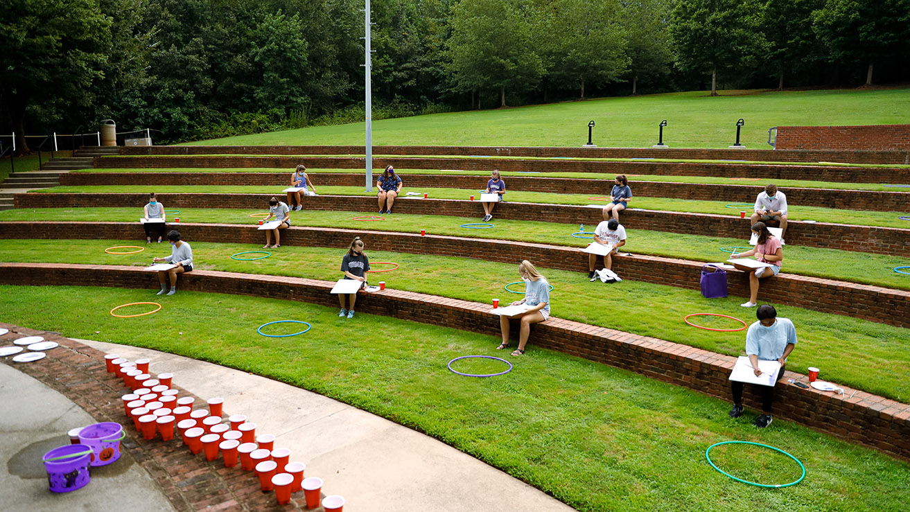 Students take a painting class in the Lakeside Amphitheater