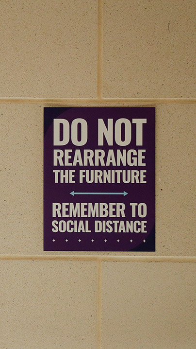 A sign warning students not to rearrange furniture