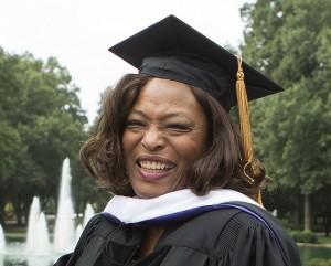 Black woman in graduation regalia