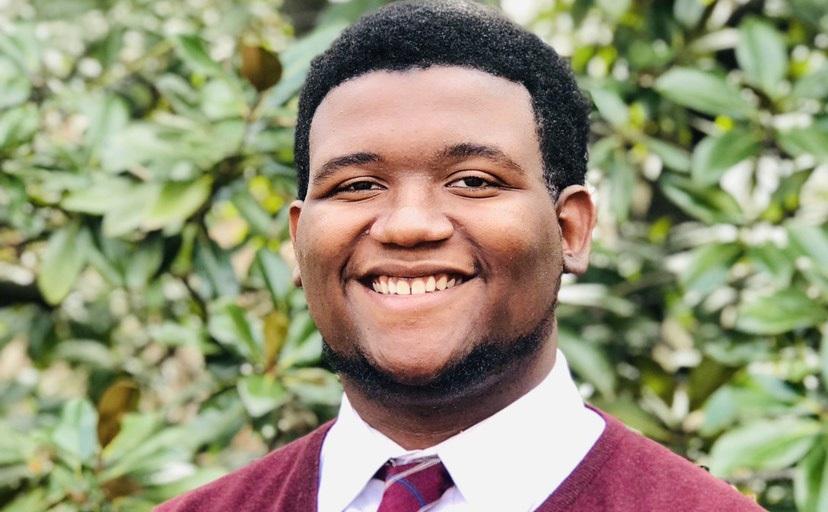 Black man in maroon sweater and tie, Quameek Bethea '21