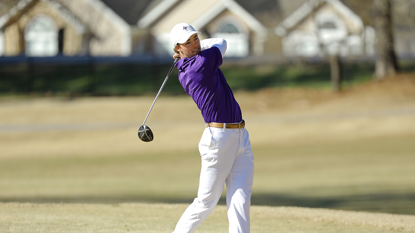 Furman men's golfer hits off the tee