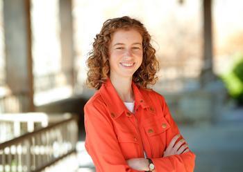 woman in orange jacket, Hannah Dailey