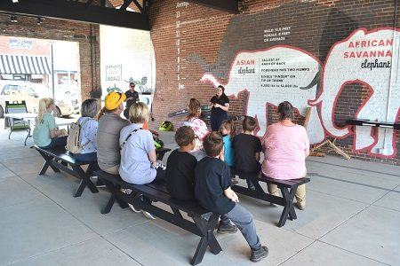 Woman leads open-air education session at The Elephant Discovery Center
