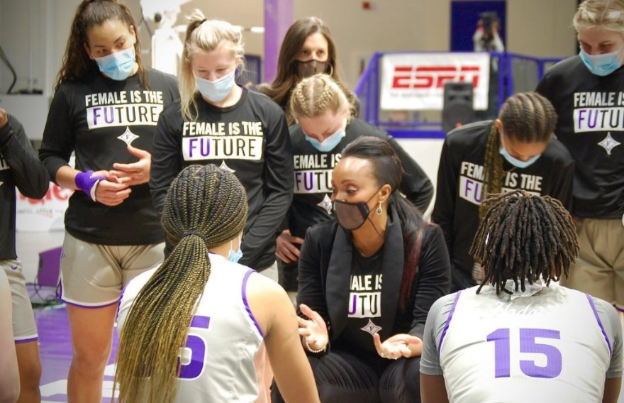 Black woman in mask coaching team, Jackie Carson