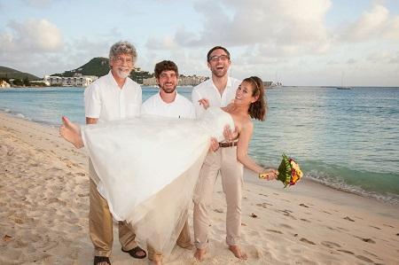 three men holding bride
