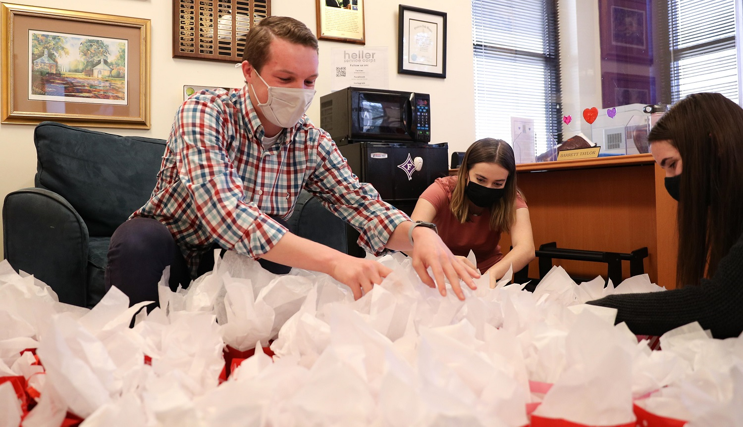 masked students preparing gift bags