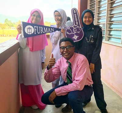 Male POC with Malaysian female students on college day