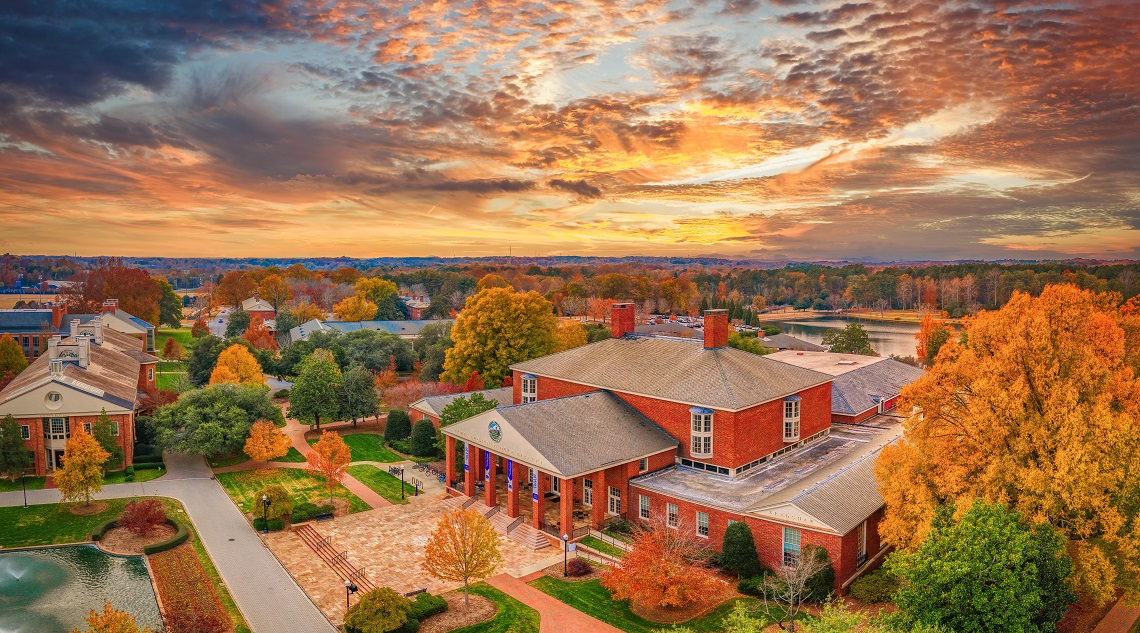 Aerial view of red brick building at sunset, Duke Library