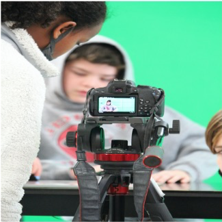 middle school students producing a news program