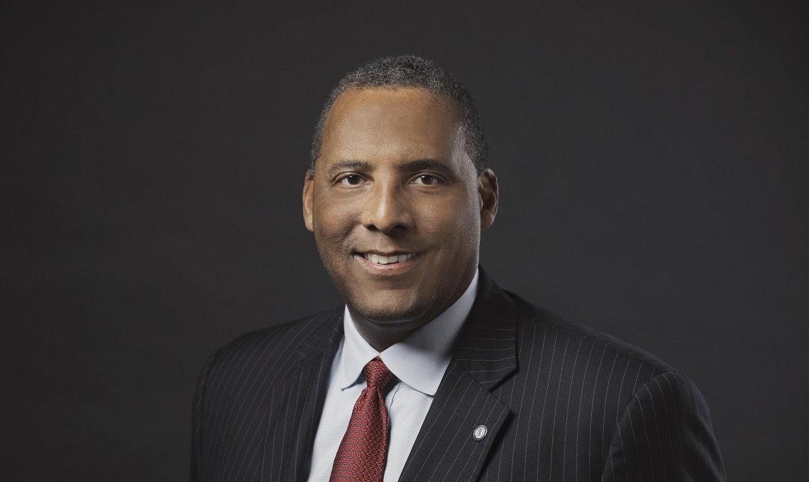 Black man in suit, Kevin Bryant '85