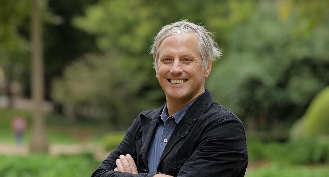 white man in dark jacket, blue shirt, Gregg Hecimovich