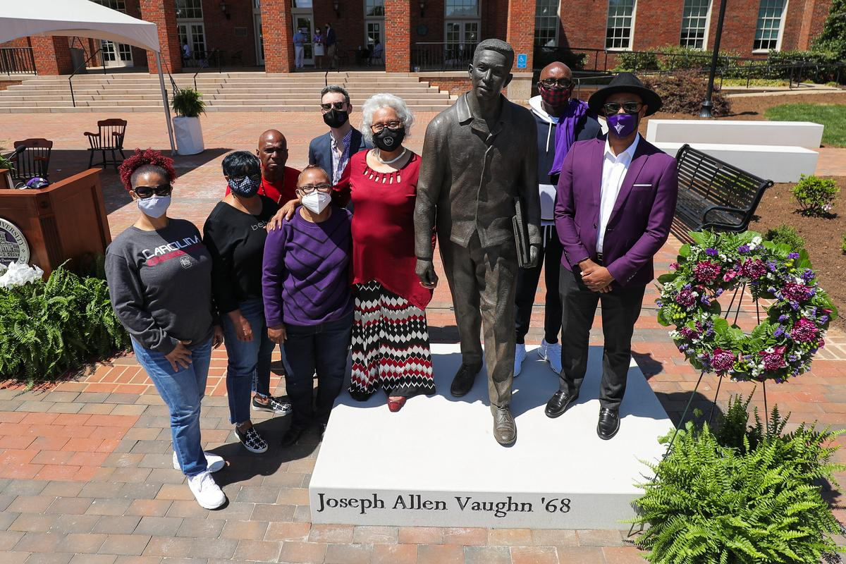 bronze statue of Joseph Vaughn flanked by family and others