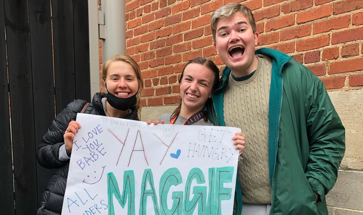 Three college students celebrate.