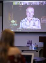 Local podcaster and investigative reporter Brad Wills chats with students in a MayX course.