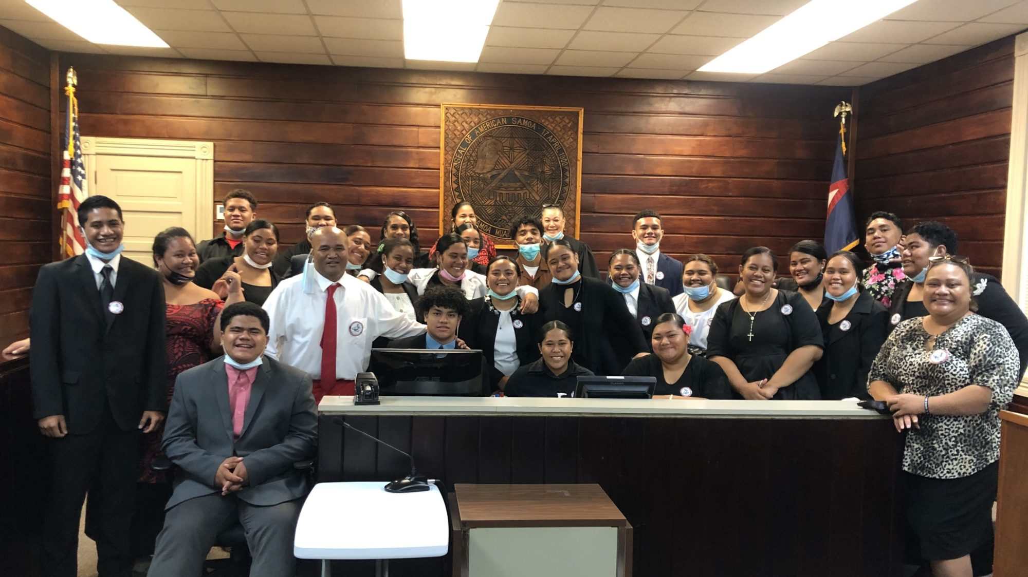 Mitzie Jessop-Taase (back row, right), former attorney general of American Samoa, helped a group of high school students stage a mock trial in the High Court of American Samoa, with the assistance of two Furman alumnae.