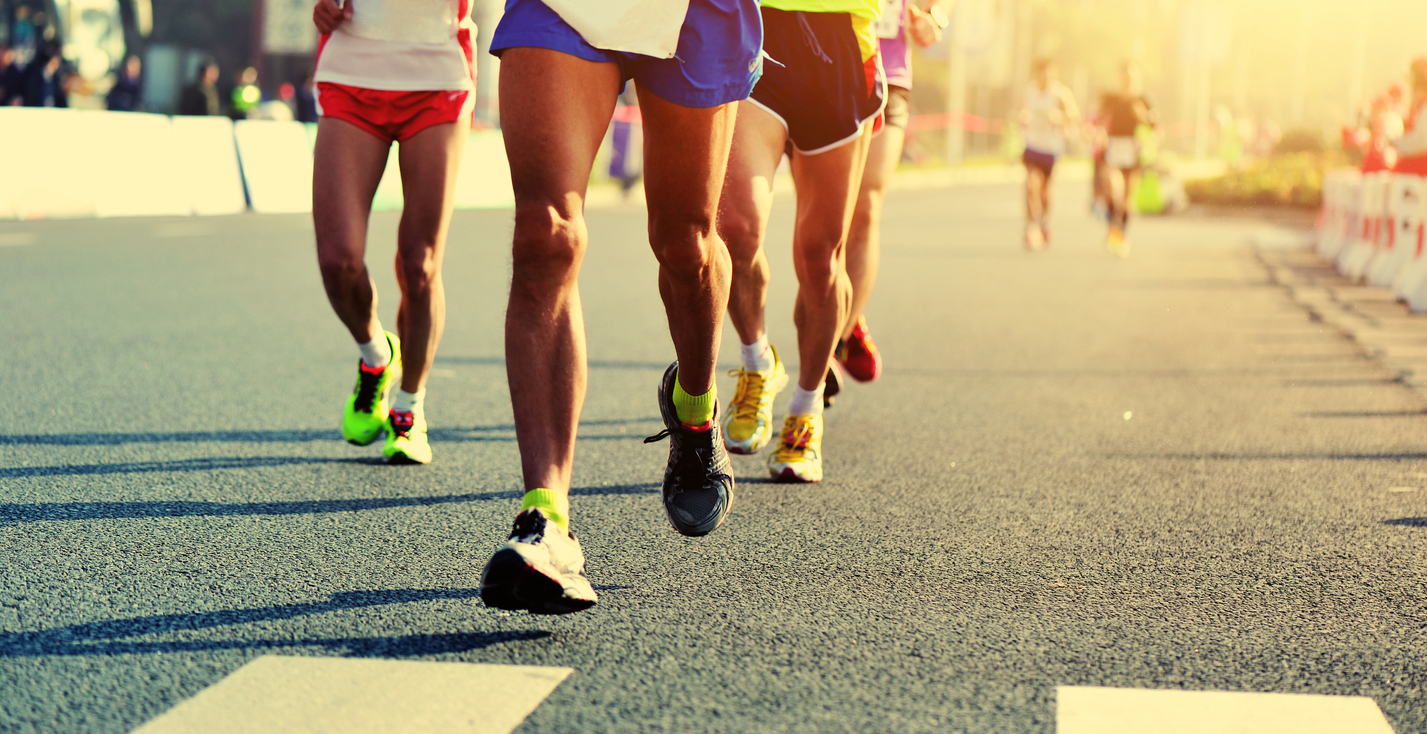 people running on asphalt