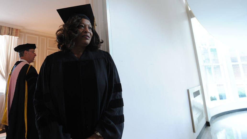 Black woman in graduation robe, Lillian Brock Flemming '71, '75(M), '14(H)