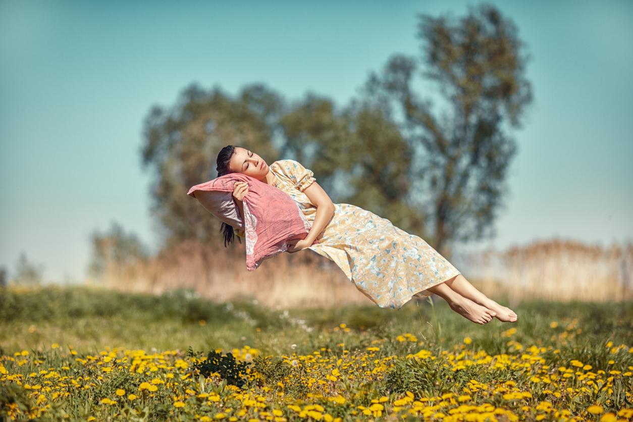 sleeping woman floating above field of flowers, iStockphoto.com