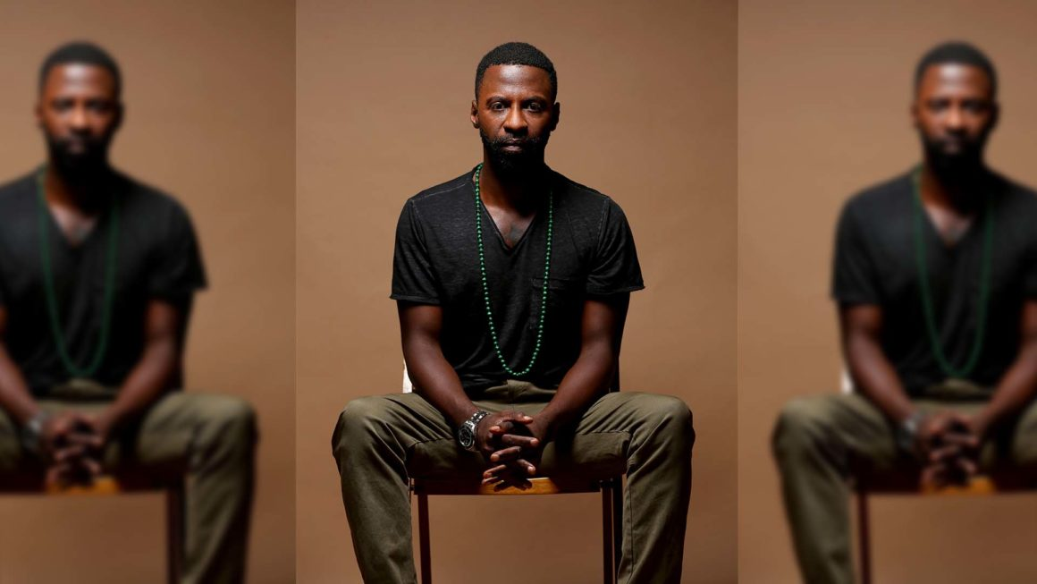Black man sitting, Jamarcus Gaston '07