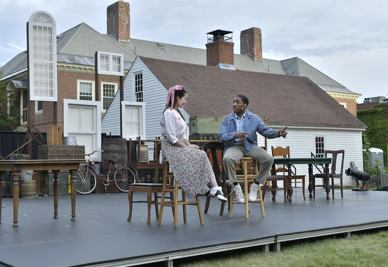 two actors on outdoor stage, The Washington Post
