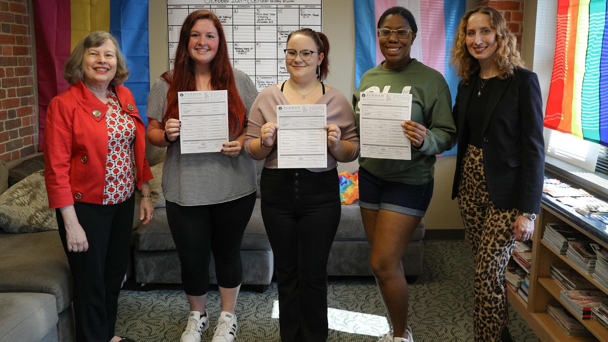 WGSS co-chairs Lynne Shackelford (far left) and Gretchen Braun (far right) join Riley Hughes '22, Miriam Stevens '22 and Queen Trapp '22 as they became the first majors in 2019.