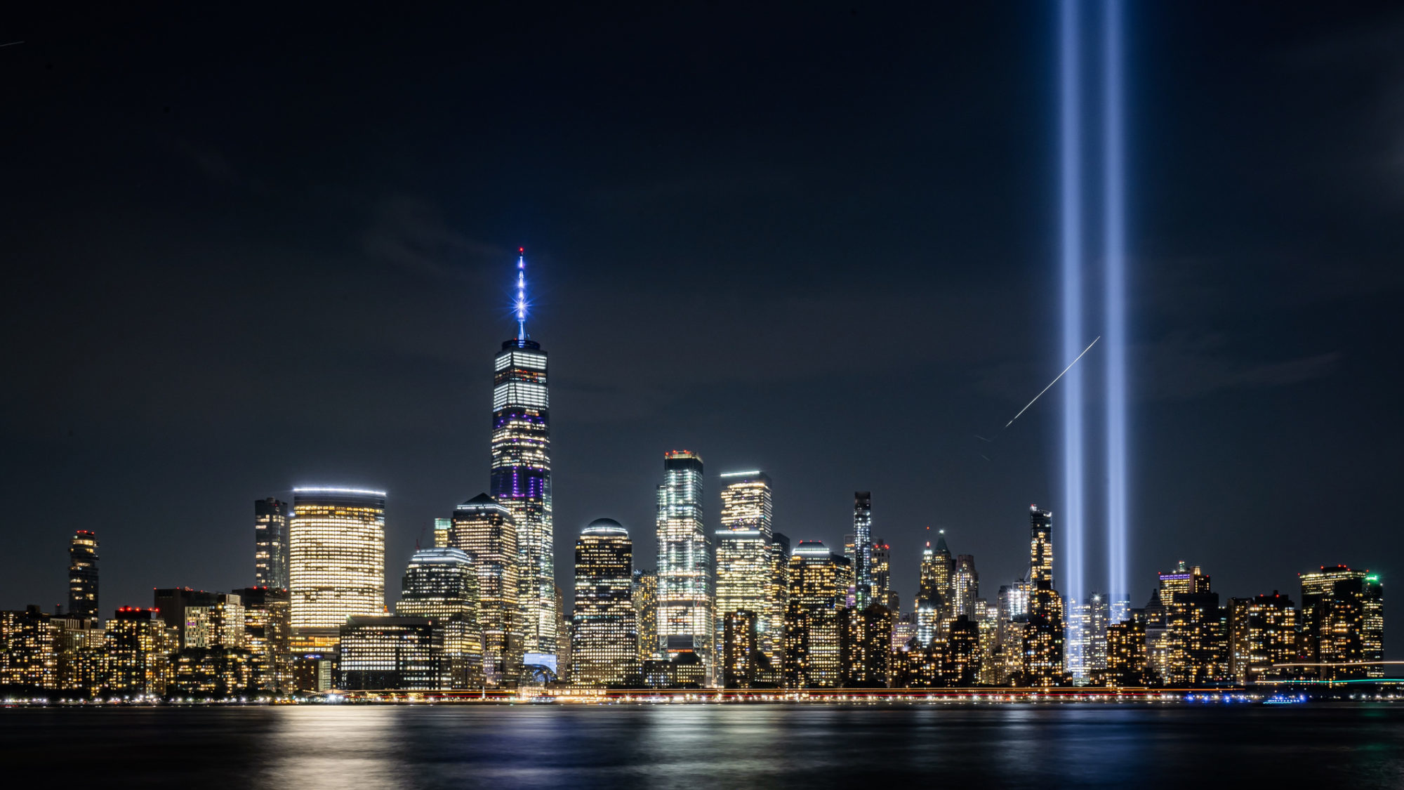 City lights on downtown Manhattan commemorate the loss of the Twin Towers on 9/11
