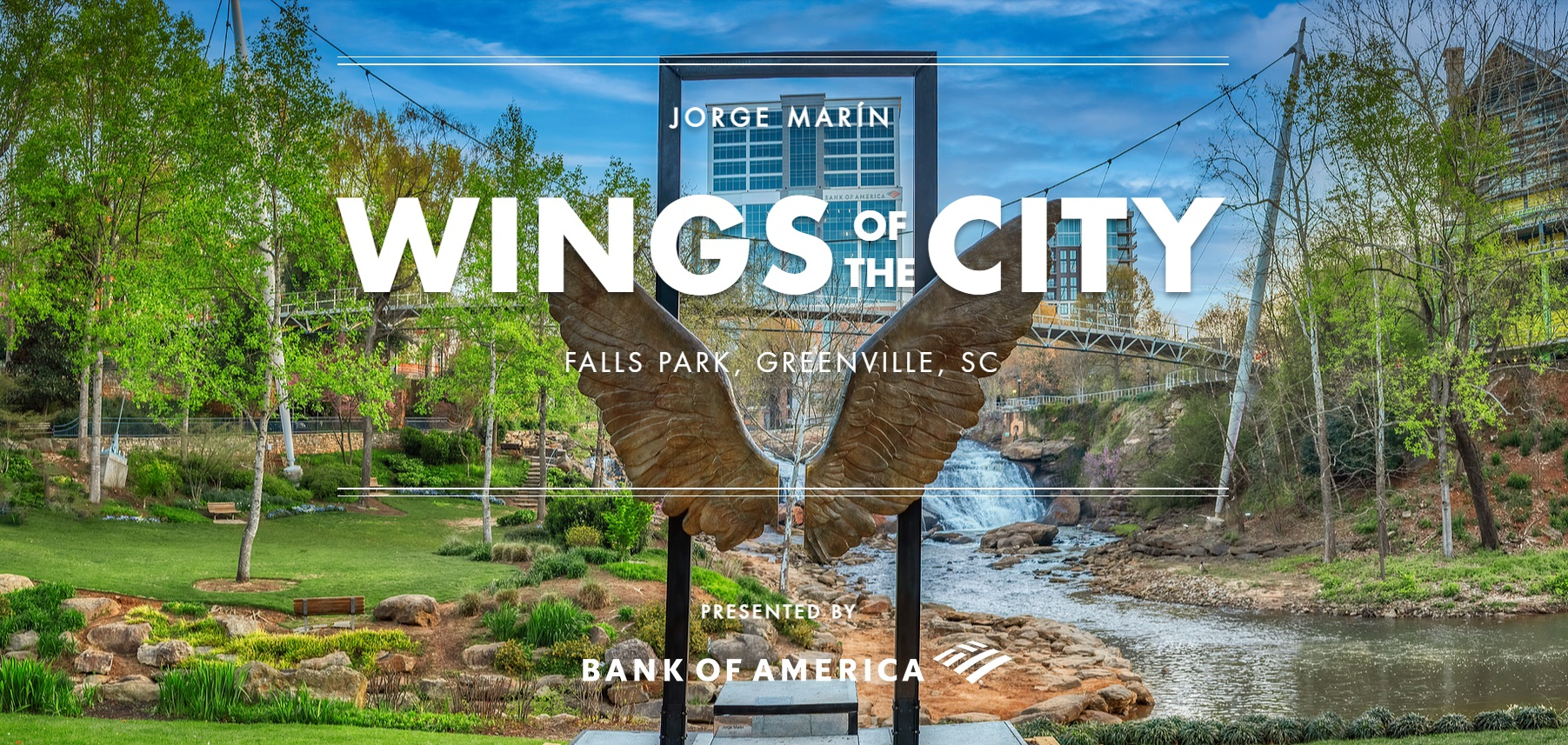 sculpture of wings in foreground of Falls Park, Greenville, South Carolina