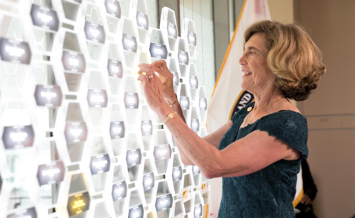 profile of white woman at light board, Frances Ligler '72