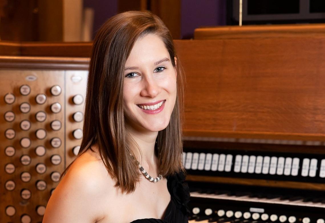 White woman at organ console, Caroline Robinson