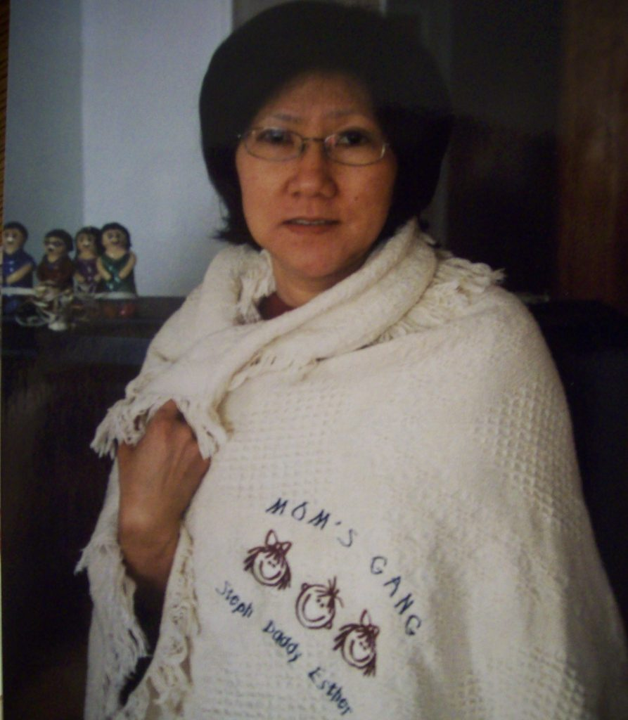 """Esther's mom sporting the """"Mom's Gang"""" blanket"""