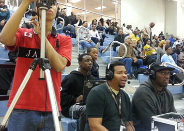 students broadcasting from a gym