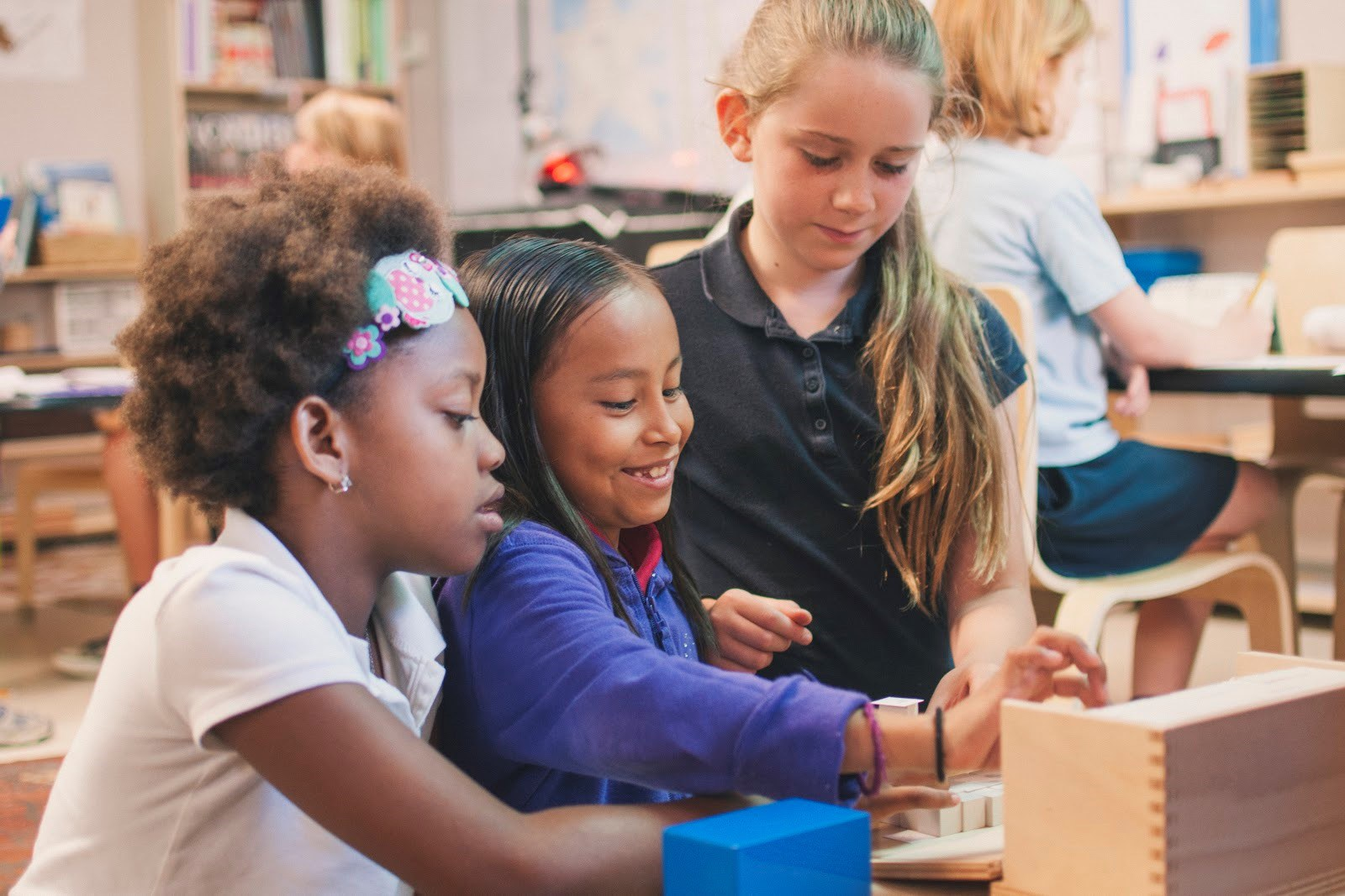 Montessori for All students building together