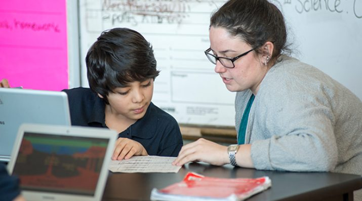 teacher working 1-on-1 with student