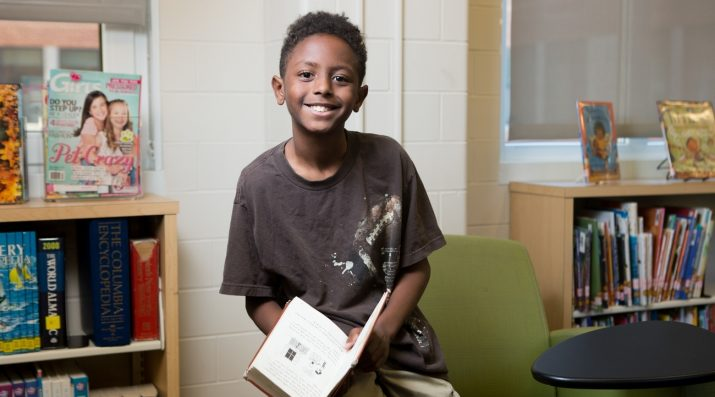 middle schooler with book