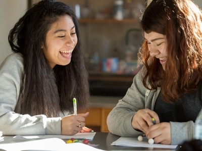 Two female High School students collaborating