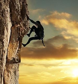 Rock Climber Reaching Success