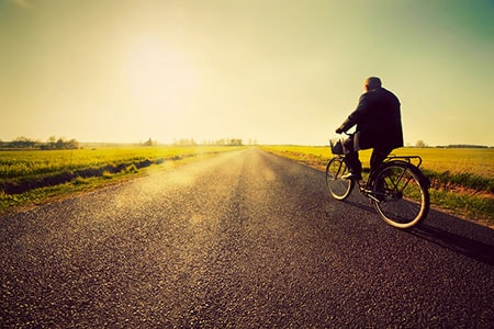 Biker on Long Road Riding to Success