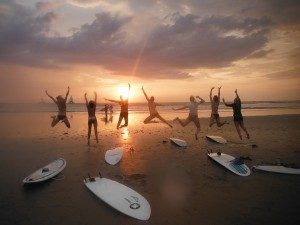 jumping beach sunset surfboards
