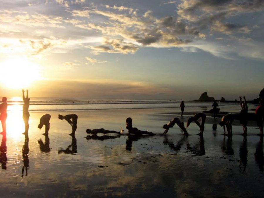 yoga poses reflective beach
