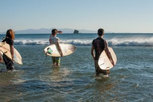 three guys in waves surf nicaragua