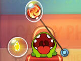 Cut the rope and pop the candy into Om Nom's mouth