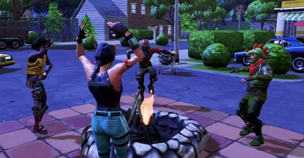 Playing Fortnite BR with friends and dancing near a campfire