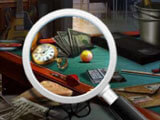 Using a magnifying glass in The New Homeowners