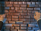 Climbing a Brick Wall in The Man with the Ivory Cane