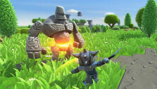 Fighting a stone monster in Portal Knights