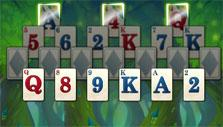 Glowing crowned cards in Solitaire in Wonderland