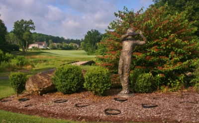 The gardens around the Great Bear clubhouse get you in the mood for golf. In the background is the conclusion of the par five 18th hole.