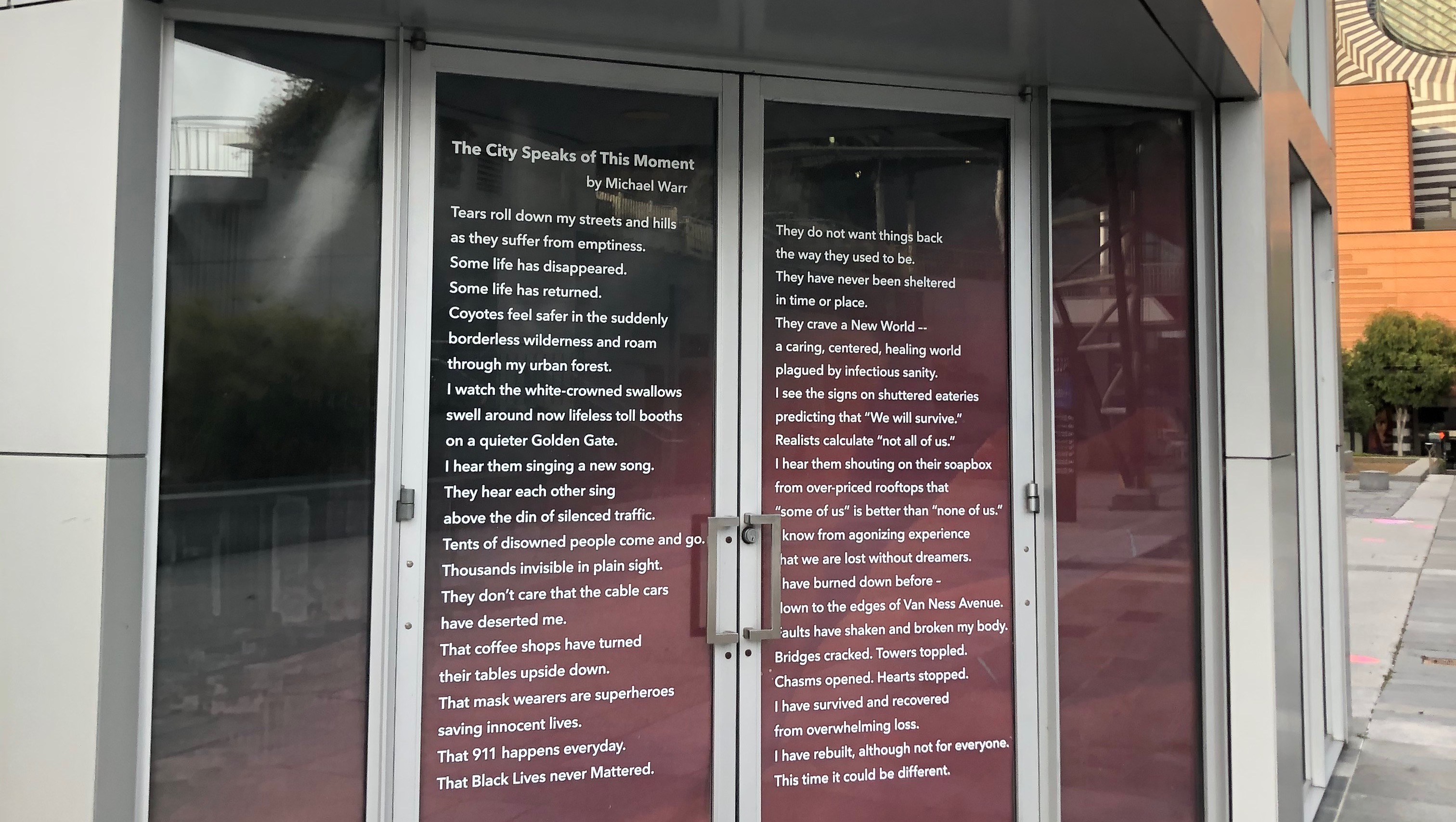 a poem printed on two doors at an art museum