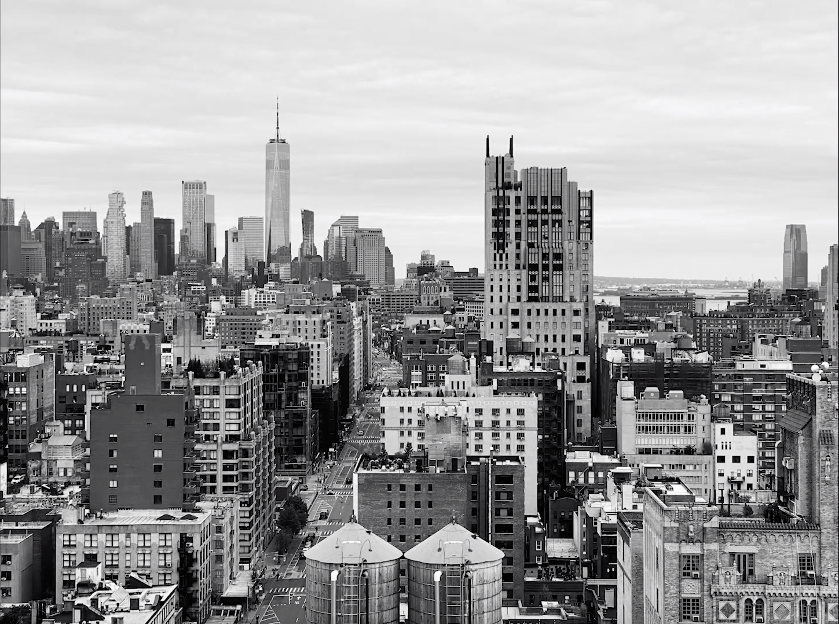 black and white image of New York City skyline with water towers