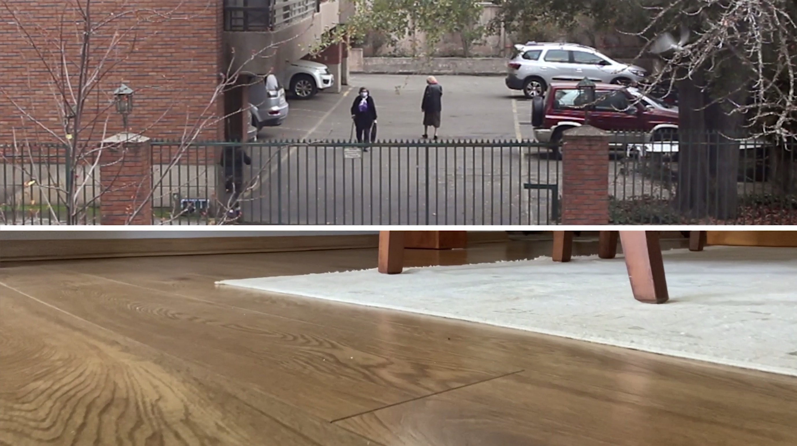 Wide Screen divided in two horizontally, top is view out of window to parking lot of brixk building and two women with masks walking, bottom image is taken at floor level of wood floor, white carpet, and table legs.